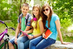 After school. Cheerful teens spending time together after school Royalty Free Stock Photos