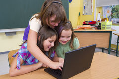 School. Pupils with computers in school Royalty Free Stock Images