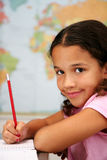 School. Child at school in front of map Royalty Free Stock Image