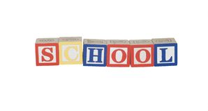 School. Toy block letters spelling school in primary colors Stock Image