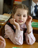 At school 7. Schoolgirl at lesson on desk Stock Image