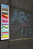 School, ABC and 123 sigh written with colored chalks on a pavement. Drawing Back to school on an asphalt. and vacation concept royalty free stock photography