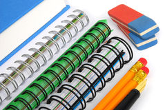 School accessories. Notebooks, pencils, erasers and pen on white background stock images