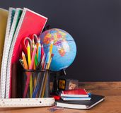 School Accessories with Blank Chalkboard Background Royalty Free Stock Images