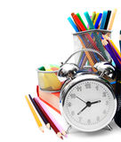 School accessories, books and alarm clock. Stock Photos