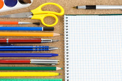 School accessories and checked notebook Stock Images