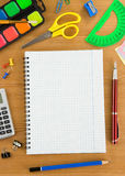 School accessories and checked notebook Royalty Free Stock Photography