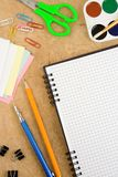 School accessories and checked notebook on wood Royalty Free Stock Photos
