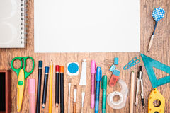 School accessories on a desk. Top view of school accessories on a desk Royalty Free Stock Images