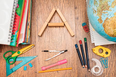 School accessories on a desk. Top view of school accessories on a desk Stock Images