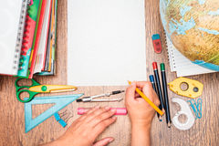 School accessories on a desk. Top view of school accessories on a desk Royalty Free Stock Photo