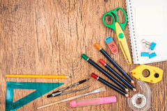 School accessories on a desk. Top view of school accessories on a desk Royalty Free Stock Photography