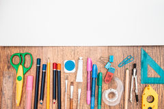 School accessories on a desk. Top view of school accessories on a desk with copy space Stock Photography