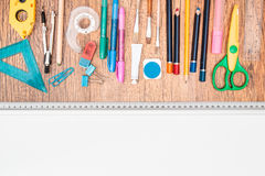 School accessories on a desk. Top view of school accessories on a desk with copy space Stock Photos