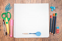 School accessories on a desk. Top view of school accessories on a desk with copy space Stock Photo