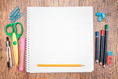 School accessories on a desk. Top view of school accessories on a desk with copy space Royalty Free Stock Photography