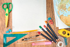 School accessories on a desk. Top view of school accessories on a desk with copy space Stock Image