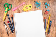 School accessories on a desk. Top view of school accessories on a desk with copy space Stock Images