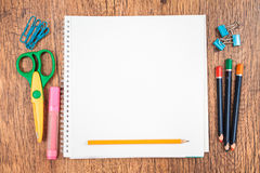 School accessories on a desk. Top view of school accessories on a desk with copy space Royalty Free Stock Images