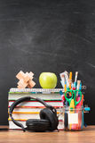 School accessories on desktop with blank blackboard in the backg Stock Image