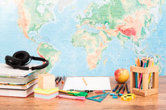 School accessories on desktop. With map at background Stock Photo