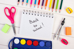 School accessories for education on white boards, back to school in notepad. School and office accessories for education on white boards, inscription back to royalty free stock photo