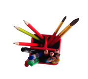 School Accessories: pencils, brushes, pens in a glass Royalty Free Stock Image
