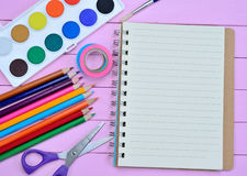 School accessories on purple table Stock Images