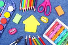 School accessories and shape of building on jeans background, back to school concept Royalty Free Stock Image