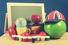 School accessories on table in classroom Royalty Free Stock Photography