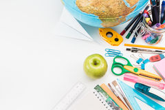 School accessories on a white background. Top view of school accessories on a desk with copy space Stock Photo