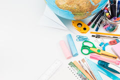 School accessories on a white background. Top view of school accessories on a desk with copy space Stock Photos