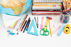 School accessories on a white background. Top view of school accessories on a desk with copy space Stock Image