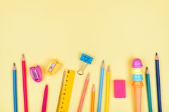 School accessories on a yellow background. Stock Image