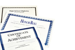 School Achievement documents including High School Diploma Royalty Free Stock Photography