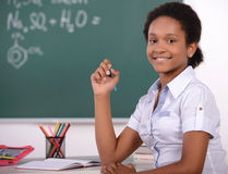 School. African American student doing math problems on the chalkboard Stock Photography