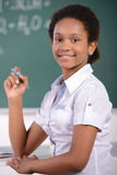 School. African American student doing math problems on the chalkboard Royalty Free Stock Photos