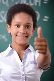 School. African American student doing math problems on the chalkboard Stock Photo
