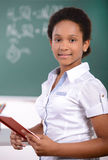 School. African American student doing math problems on the chalkboard Stock Images