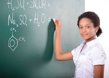 School. African American student doing math problems on the chalkboard Royalty Free Stock Photo