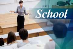 School against teacher standing talking to the students Stock Photos