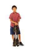 School age African boy standing with skate board Royalty Free Stock Image