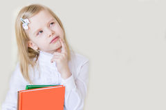School-age child with a book. Royalty Free Stock Images