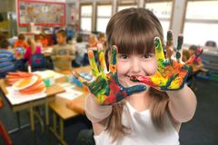 School Age Child Painting With Her Hands in Class Royalty Free Stock Photography