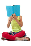 School Age Child Reading a Blue Book Royalty Free Stock Photography