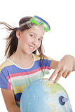 School age girl with globe Stock Photo