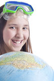 School age girl with globe foreground Royalty Free Stock Image
