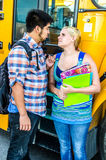 School age teenagers waiting to get on bus Royalty Free Stock Photography