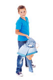 Boy with clothes pile Stock Images