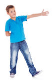 Showing direction. School aged boy showing direction Royalty Free Stock Photography